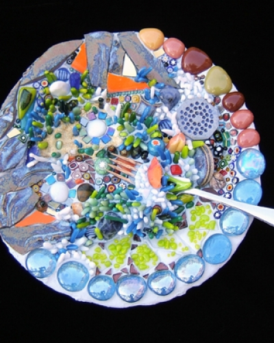 blue-themed ceramic and glass mosaic plate by Lynn Bridge
