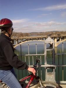 cyclist on Pfluger Pedestrian Bridge over Lady Bird Lake in Austin, Texas, U.S.A.