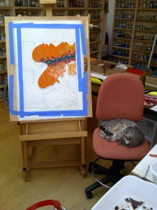 cat asleep in a mosaic studio next to a mosaic work-in-progress