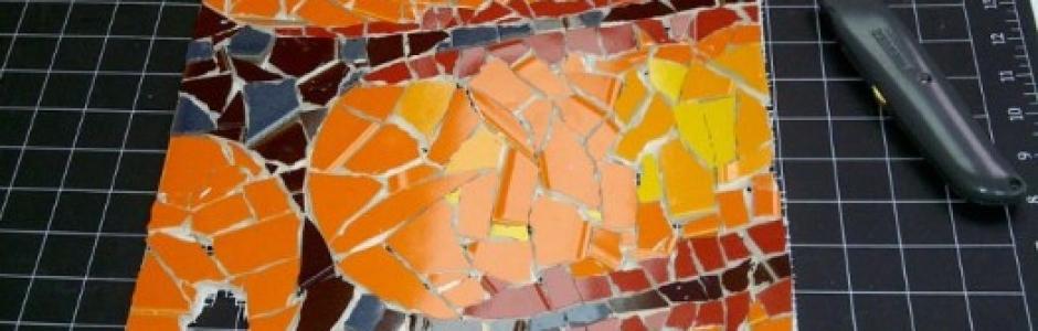 orange mosaic ammonite fossil work-in-progress by Lynn Bridge, Austin, Texas mosaic artist