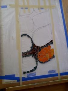 orange ammonite fossil mosaic work-in-progress by Lynn Bridge
