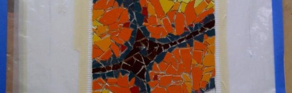 orange ammonite fossil mosaic work-in-progress by Lynn Bridge, mosaic artist in Austin, Texas