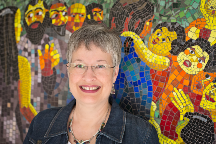 Nina Miller's photographic portrait of Lynn Bridge in front of a mosaic wall