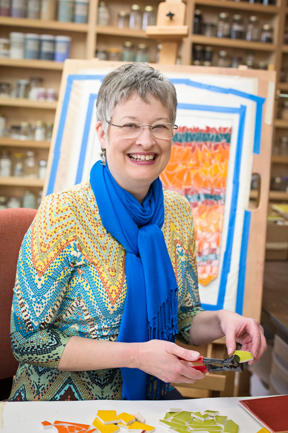 Nina Miller's photographic portrait of Lynn Bridge in her mosaic studio