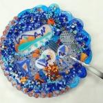 blue and orange mosaic plate made by Lynn Bridge, Austin, Texas mosaic artist