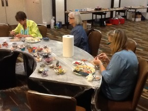 Making found-object flowers for a mosaic panel at SAMA 2014 in Houston, Texas